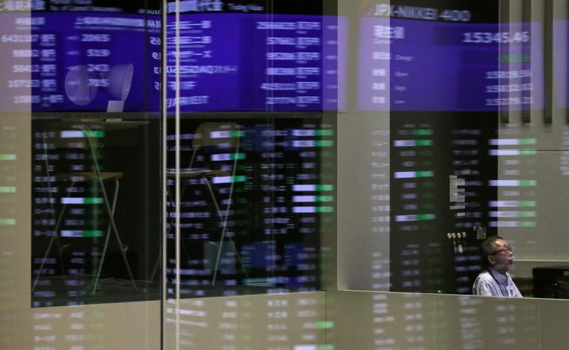 FILE PHOTO: Market prices are reflected in a glass window at the Tokyo Stock Exchange (TSE) in Tokyo, Japan, February 6, 2018.  REUTERS/Toru Hanai